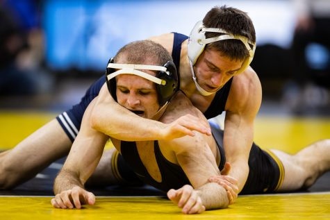 Iowa's 141-pound Carter Happel wrestles Penn State's Nick Lee during a wrestling dual meet between No. 1 Iowa and No. 2 Penn State at Carver-Hawkeye Arena on Jan. 31. No. 2 Lee defeated Happel by technical fall in 5:53, and the Hawkeyes defeated the Nittany Lions, 19-17.