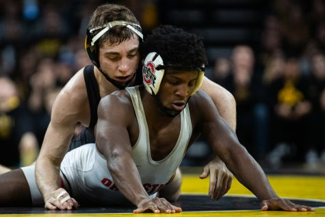 Iowa's 133-pound Austin DeSanto wrestles Ohio State's Jordan Decatur during a wrestling dual meet between No. 1 Iowa and No. 4 Ohio State at Carver-Hawkeye Arena on Friday, Jan. 24, 2020. No. 2 DeSanto defeated No. 18 Decatur by technical fall in 5:59, and the Hawkeyes defeated the Buckeyes, 24-10. (Shivansh Ahuja/The Daily Iowan)