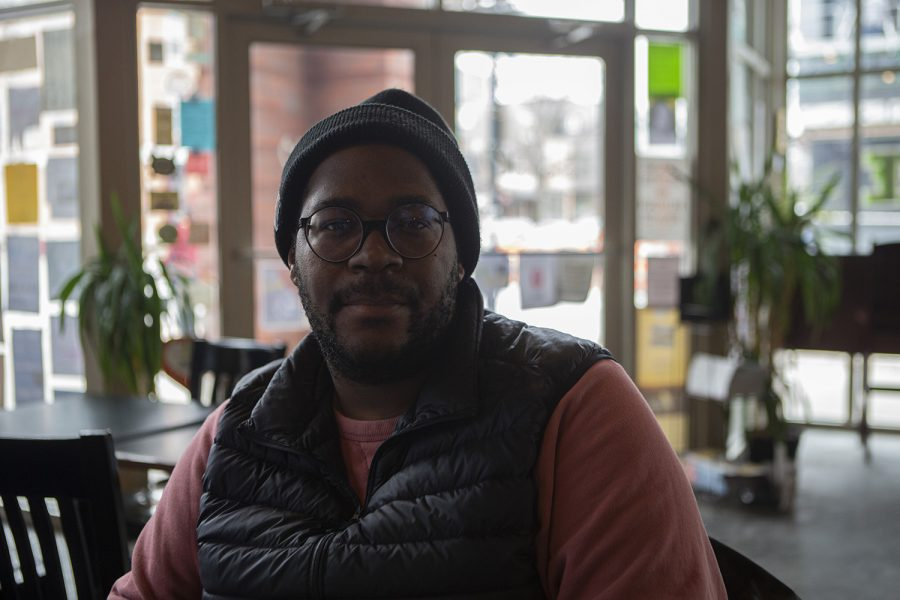 "Iowa Writers' Workshop graduate Brandon Taylor poses for a portrait during an interview with The Daily Iowan about his debut novel ""Real Life"" in High Ground Cafe on Wednesday, Feb. 19, 2020."