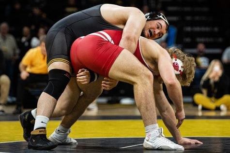 Iowa's 285-pound Tony Cassioppi wrestles Wisconsin's Trent Hillger during a wrestling match between No.1 Iowa and No. 6 Wisconsin at Carver-Hawkeye Arena on Sunday, Dec. 1, 2019. Cassioppi won by decision, 3-2, and the Hawkeyes defeated the Badgers, 32-3.
