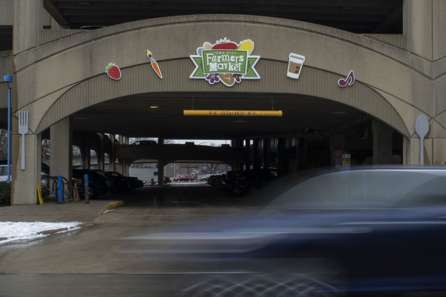 The Iowa City Farmers Market sign is seen above the entrance of Chauncey Swan Parking Ramp on Monday, Feb. 17, 2020.