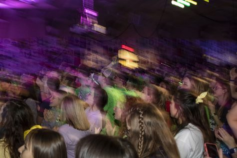 "Dancers participate in the halfway mark of Dance Marathon in the IMU Main Ballroom on Saturday, Feb. 8, 2020. Dancers listened to ""Livin on a Prayer"" to mark the halfway point."