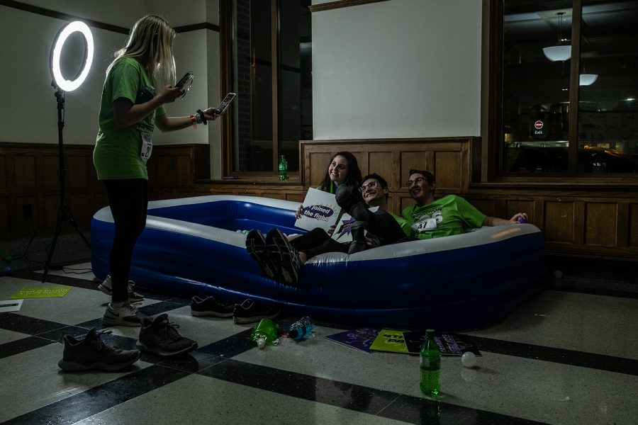 A dancer takes a photo of (from left) University of Iowa Freshman Abigail Kurten, Alec Glisson, and Isaac Jahn during Dance Marathon 26 on Friday, Feb. 7, 2020. This is the first Big Event for each of the students.