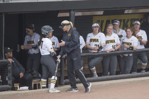 Iowa fielder Lea Thompson receives coaching from head coach Renee Gillispie after striking out during the conference opening softball game at Pearl Field on Friday, March 29, 2019. The Wildcats defeated the Hawkeyes 5-0.