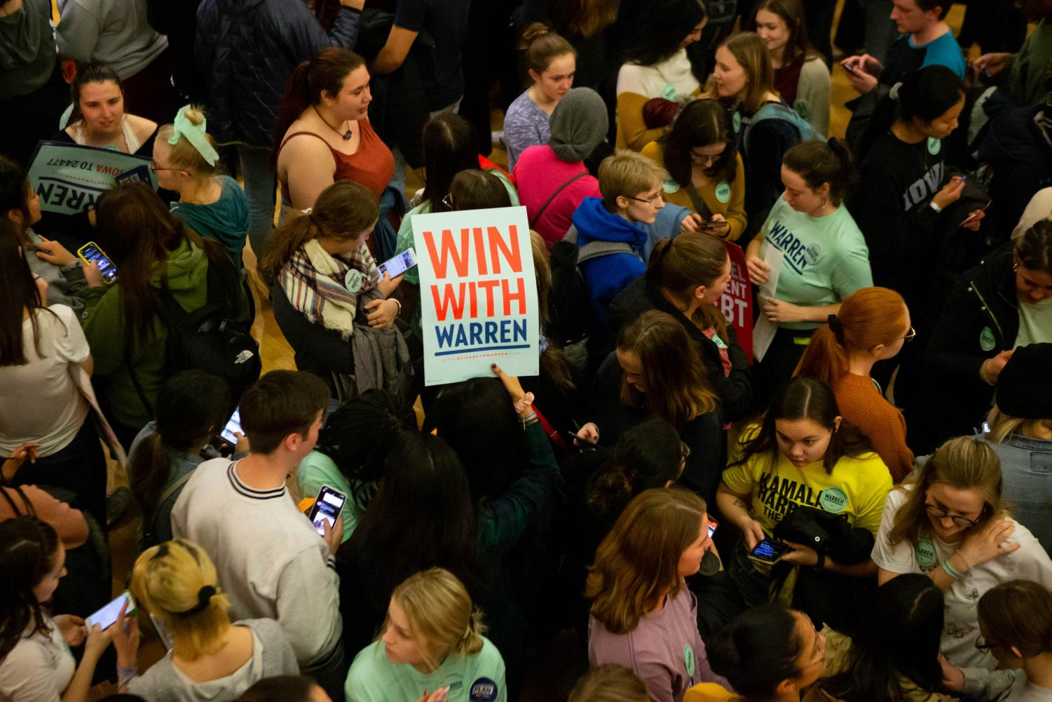 A sign for Sen. Elizabeth Warren, D-Mass. is seen during a caucus at the Iowa Memorial Union on Feb. 3.