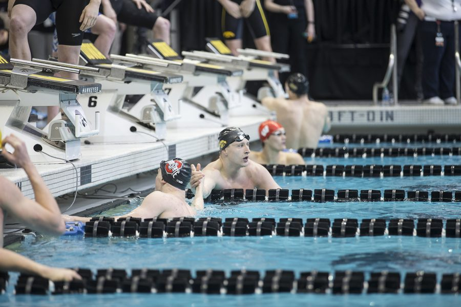 Iowa+junior+Joe+Joe+Myhre+high+fives+a+swimmer+while+checking+the+results+of+the+100+freestyle+during+preliminary+rounds+of+the+men%27s+Big+10+Swimming+Championships+on+Saturday%2C+March+3%2C+2019.