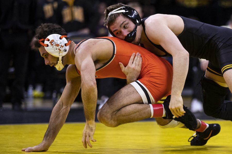 Iowa%E2%80%99s+125-pound+Spencer+Lee+grapples+with+Oklahoma+State%E2%80%99s+Nick+Piccininni+during+a+wrestling+dual+meet+between+No+1.+Iowa+and+No.+9+Oklahoma+State+at+Carver-Hawkeye+Arena+on+Sunday%2C+Feb.+23%2C+2020.++No.+1+Lee+defeated+No.+4+Piccininni+by+major+decision%2C+12-3%2C+and+the+Hawkeyes+defeated+the+Cowboys%2C+34-6.+