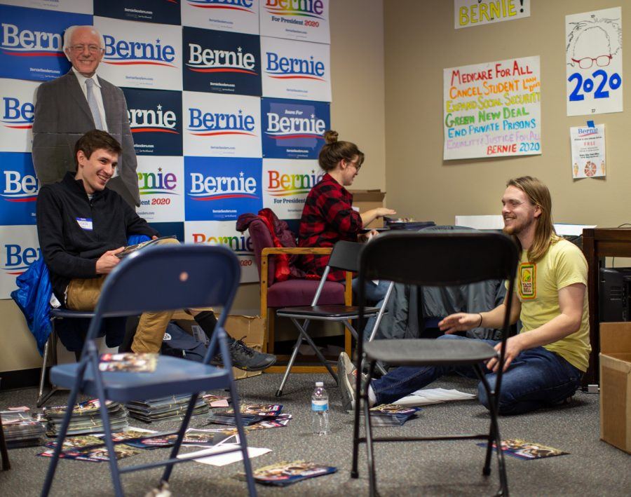 Volunteers working for Sen. Bernie Sanders, I-VT sort flyers at Sanders' field office in Iowa City on Sunday, Feb. 2. Sanders is one of 11 candidates vying for the 2020 Democratic Presidential nomination.