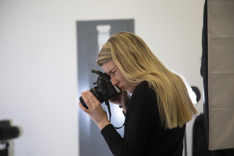 University of Iowa student Olivia Harter takes photos in the Visual Arts Building on Sunday, Feb. 9, 2020.
