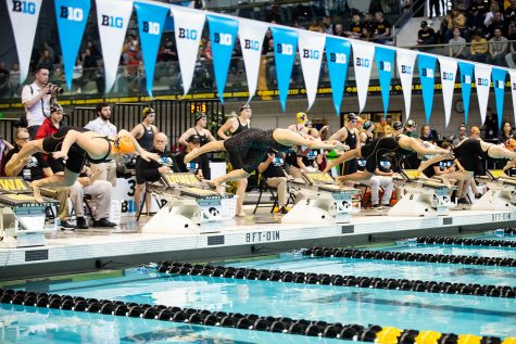 Swimmers dive into the pool during the 100 Breast during the second session of the the 2020 Big Ten Women's Swimming and Diving Championship at the the HTRC on Friday, Feb. 21, 2020.