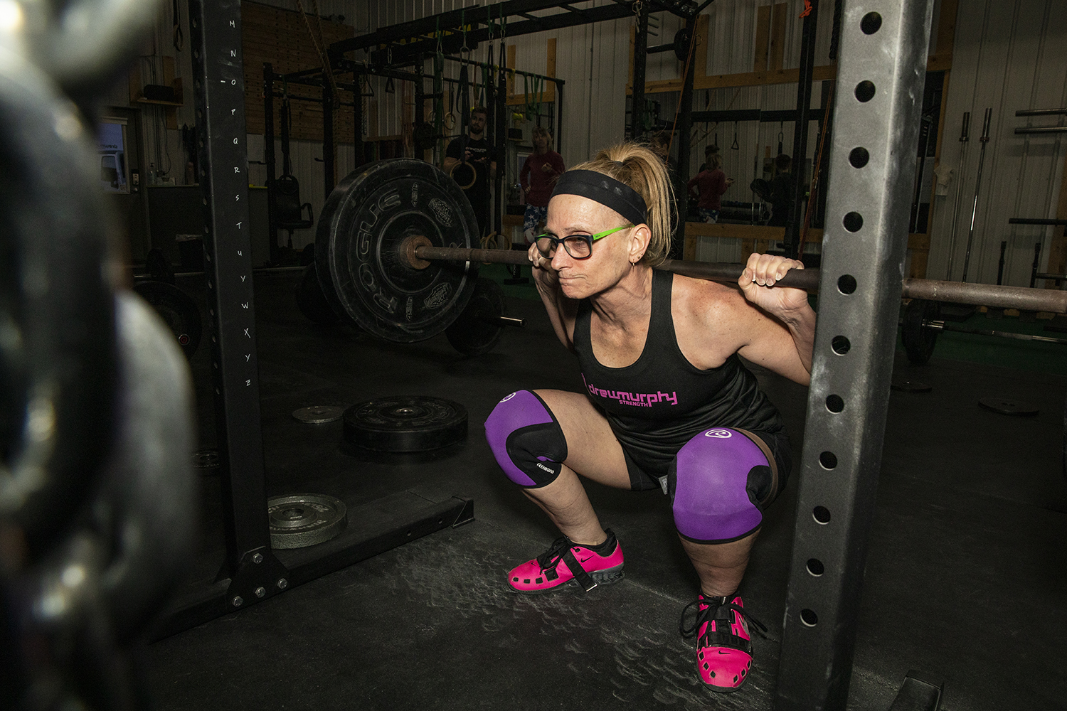 Powerlifting competitor Linda Smith performs a squat at Drew Murphy Strength in Tiffin, Iowa on Thursday Feb. 13, 2019. Smith recently set four deadlifting records in an Iowa competition through USA Powerlifting.