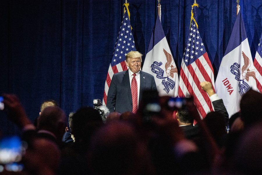 President Donald Trump pauses during a speech at the Iowa GOP's America First Dinner at the Ron Pearson Center in West Des Moines on June 11, 2019.