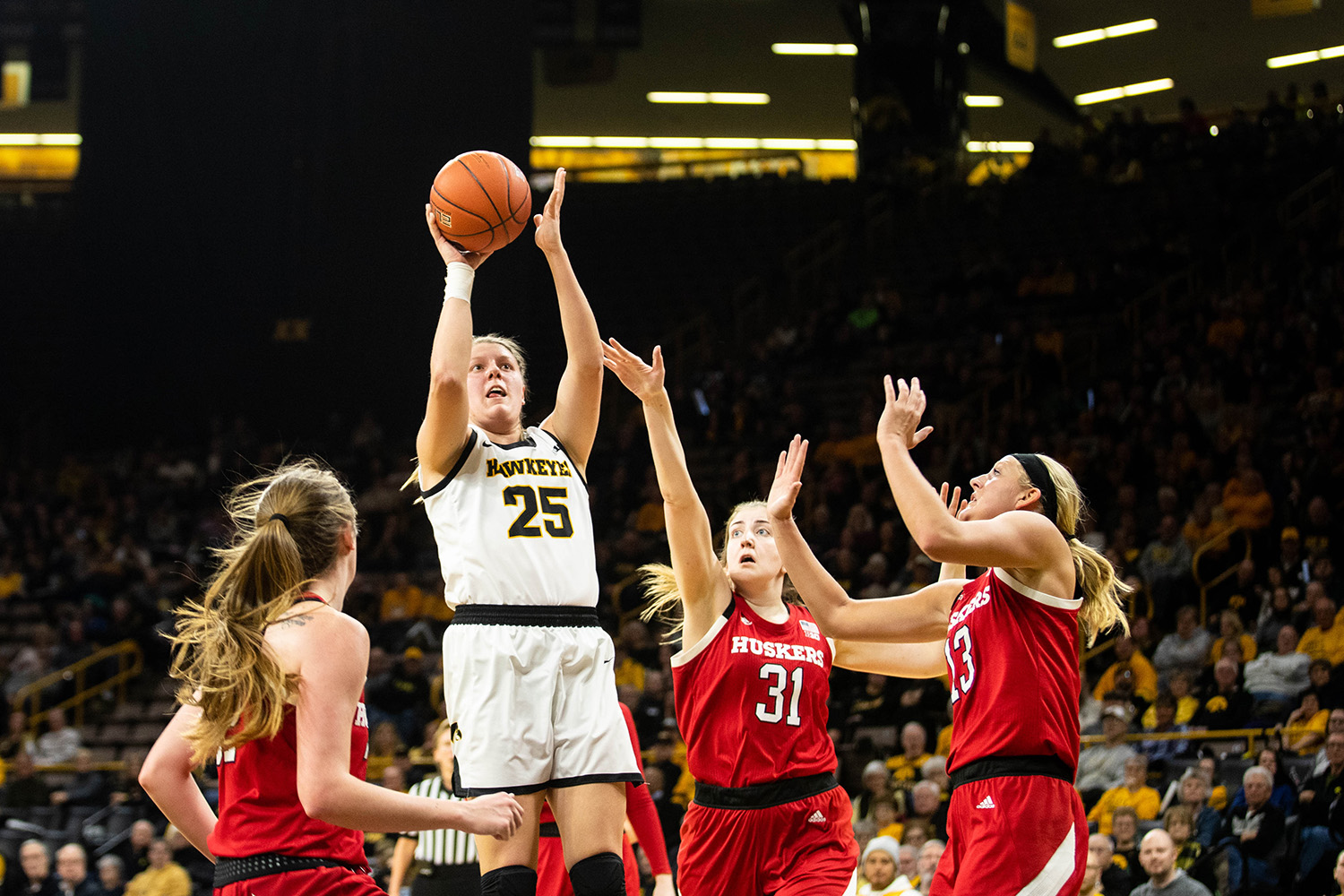 Iowa center Monika Czinano shoots during a women's basketball game between Iowa and Nebraska at Carver-Hawkeye Arena on Thursday. The Hawkeyes defeated the Cornhuskers 76-60.