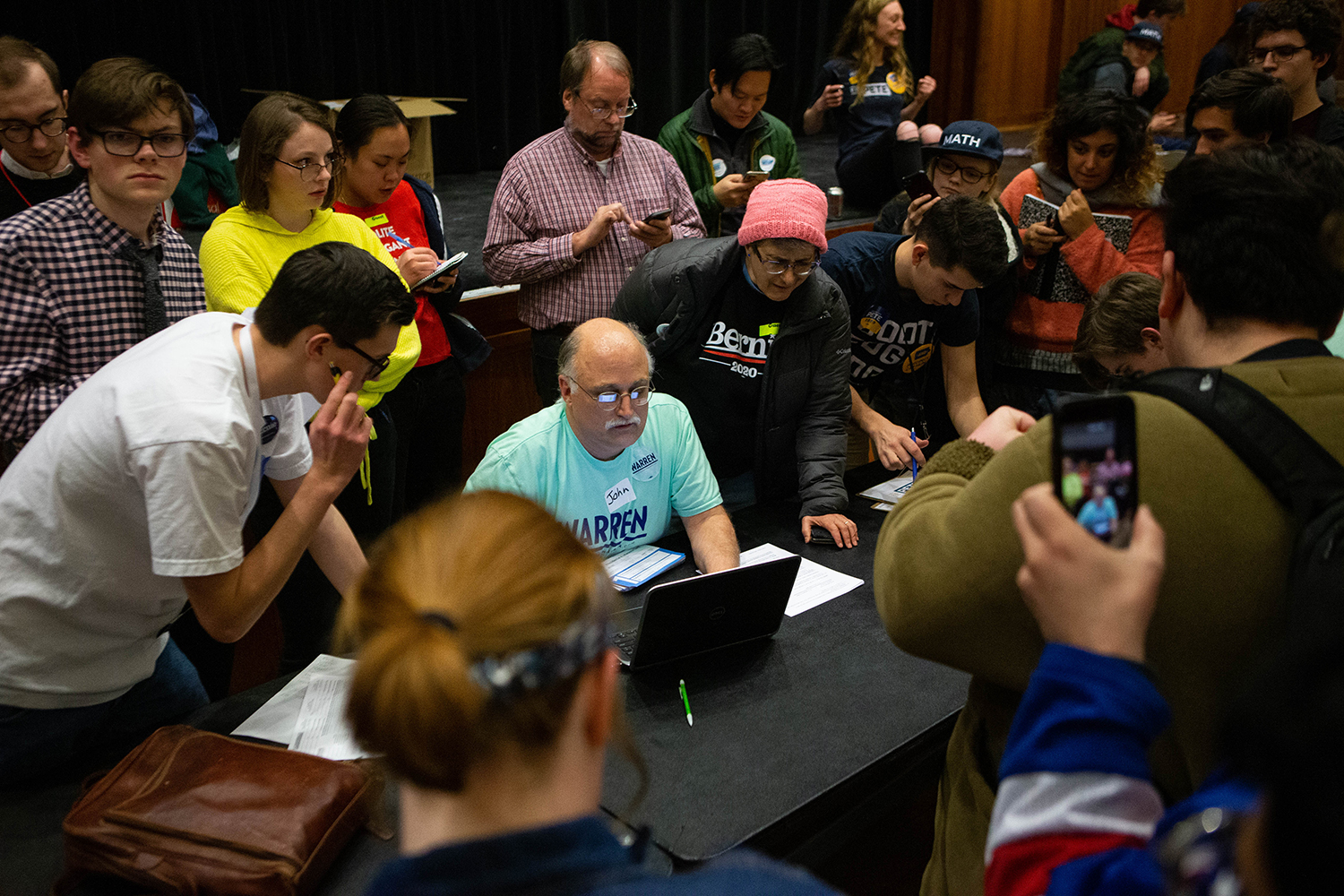 John Deeth, volunteer from Johnson County Democrats, recounts before assigning delegates during the caucus at the Iowa Memorial Union on Monday February 3, 2020.