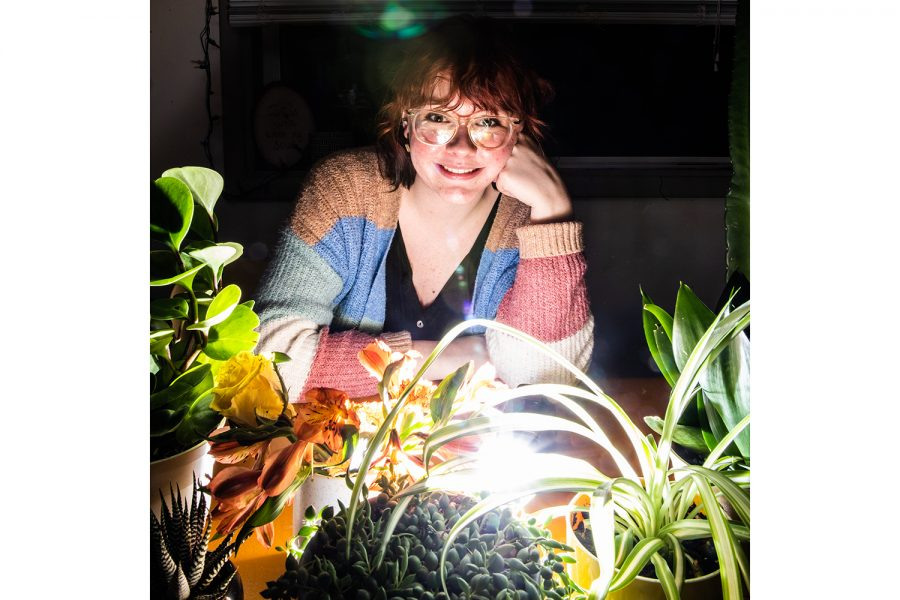 Kali Schelby poses for a portrait in her apartment on Sunday, February 16, 2020. Schelby has multiple plants in her home, including a 4-foot tall cactus, succulents, and flowers.