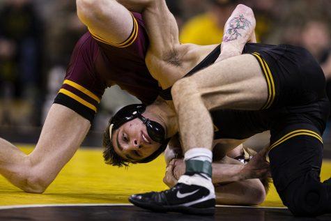 Iowa's 133-pound Austin DeSanto wrestles Minnesota's Boo Dryden during a wrestling dual meet between No. 1 Iowa and No. 13 Minnesota at Carver-Hawkeye Arena on Saturday, Feb. 15, 2020.