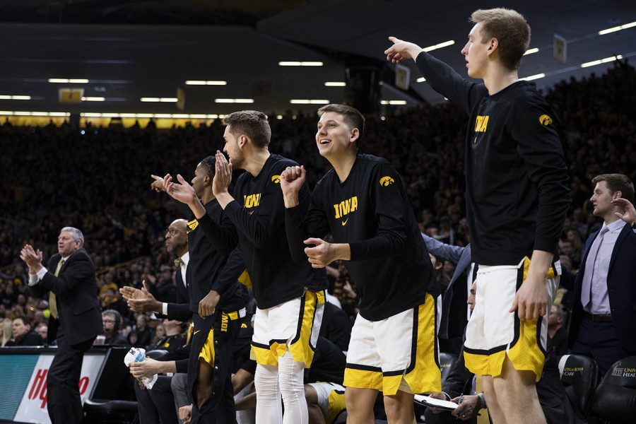 Members of the Iowa Hawkeyes celebrate during a men's basketball game between Iowa and Penn State on Saturday, Feb. 29 at Carver-Hawkeye Arena. The Hawkeyes defeated the Nittany Lions 77-68. (Nichole Harris/The Daily Iowan)