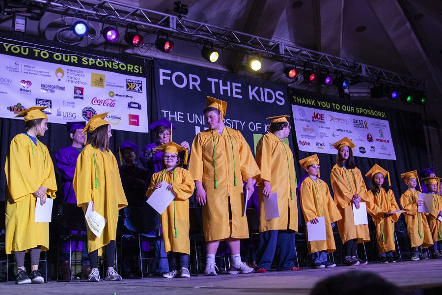 Kids switch their tassle to the right during Kiddo Graduation at Dance Marathon 26 in the IMU on Saturday, Feb. 8, 2020. (Katie Goodale/The Daily Iowan)
