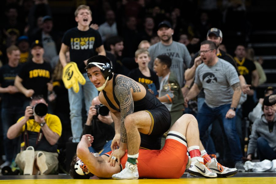 Iowa%E2%80%99s+149-pound+Pat+Lugo+grapples+with+Oklahoma+State%E2%80%99s+Boo+Lewallen+during+a+wrestling+dual+meet+between+No.+1+Iowa+and+No.+9+Oklahoma+State+at+Carver-Hawkeye+Arena+on+Sunday%2C+Feb.+23%2C+2020.+No.+2+Lugo+defeated+No.+6+Lewallen+by+fall+in+2%3A22%2C+and+the+Hawkeyes+defeated+the+Cowboys%2C+34-6.+%28Shivansh+Ahuja%2FThe+Daily+Iowan%29