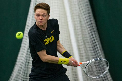 Iowa's Jason Kerst hits a backhand during a men's tennis match between Iowa and VCU on Saturday, Feb. 29, 2020. The Hawkeyes defeated the Rams, 4-3.