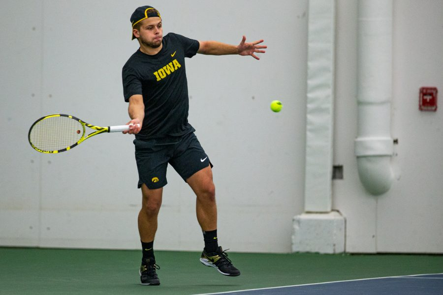 Iowa's Will Davies hits a forehand during a men's tennis match between Iowa and VCU on Saturday, Feb. 29, 2020.