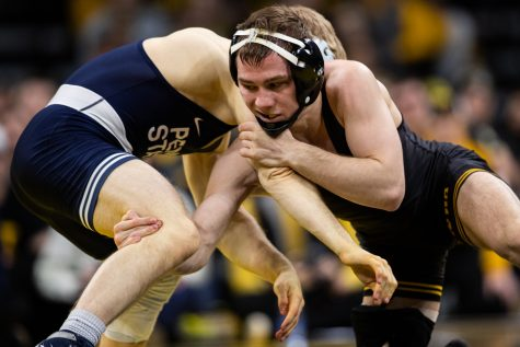 Iowa's 125-pound Spencer Lee wrestles Penn State's Brandon Meredith during a wrestling dual meet between No. 1 Iowa and No. 2 Penn State at Carver-Hawkeye Arena on Friday, Jan. 31, 2020. No. 1 Lee won by technical fall in 3:18, and the Hawkeyes defeated the Nittany Lions, 19-17.