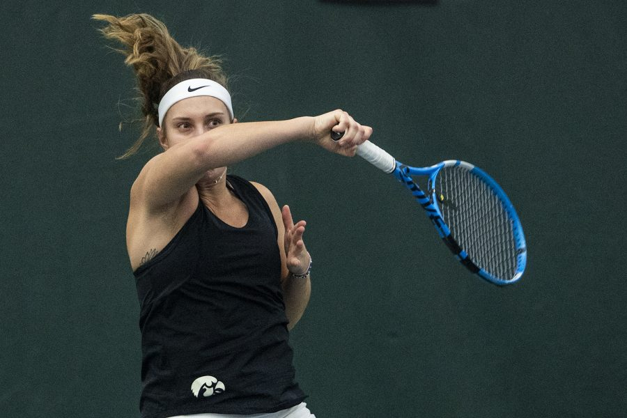 Iowa's Ashleigh Jacobs hits a forehand during a women's tennis match between Iowa and DePaul at the HTRC on Friday, Feb. 21, 2020. The Hawkeyes defeated the Blue Demons, 6-1.