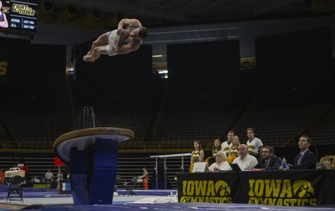 Iowa's all-around Carter Tope performs on the vault during a men's gymnastics meet between Iowa and Illinois at Carver Hawkeye Arena on March 1, 2020. The Hawkeyes tied with the Fighting Illini with a score of 403.050. Tope earned a score of 14.150.