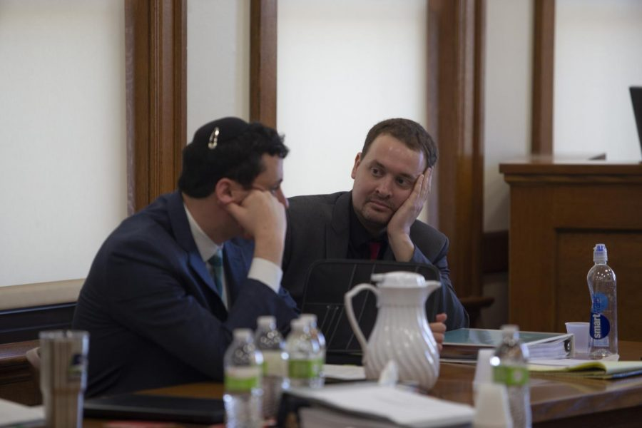 Former Hillel director David Weltman confers with his attorney Christopher Foster during the third and final day of trial on Thursday, 5, 2020, at the Johnson County Courthouse. Weltman was convicted of second-degree sexual abuse, a Class B felony. (Emily Wangen/The Daily Iowan)