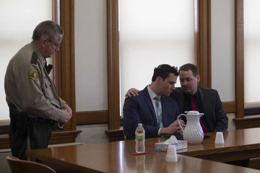 Former Iowa Hillel Director David Weltman confers with his attorney Christopher Foster during the third and final day of trial on Thursday, March 5, 2020, at the Johnson County Courthouse. Weltman was found guilty of second-degree sexual abuse, a Class-B felony.