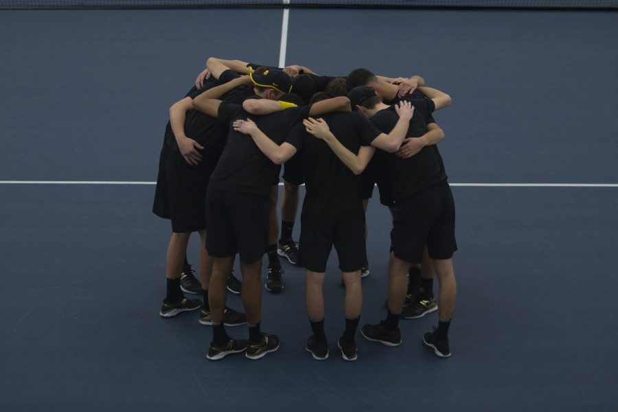 Iowa+players+huddle+on+the+court+before+a+men%E2%80%99s+tennis+match+between+Iowa+and+Louisville+on+Friday%2C+March+6%2C+2020+at+The+Hawkeye+Tennis+%26amp%3B+Recreation+Complex.+The+Hawkeyes+defeated+the+Cardinals+4-1.+