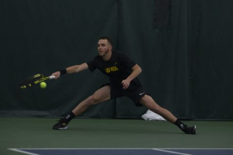 Iowa's Kareem Allaf reaches for the ball during a men's tennis match between Iowa and Louisville on Friday, March 6, 2020 at The Hawkeye Tennis & Recreation Complex. The Hawkeyes defeated the Cardinals 4-1.