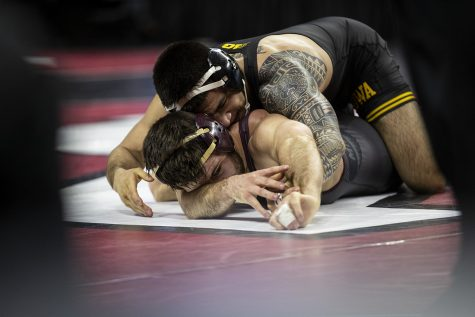 Iowa's 149-pound Pat Lugo grapples with Minnesota's Brayton Lee during session two of the Big Ten Wrestling Tournament in Piscataway, NJ on Saturday, March 7, 2020. Lugo won by major decision, 11-3.