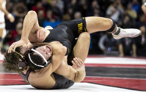 Iowa's 174-pound Michael Kemerer grapples with Minnesota's Devin Skatzka during session two of the Big Ten Wrestling Tournament in Piscataway, NJ on Saturday, March 7, 2020. Kemerer won by major decision, 22-9. ]