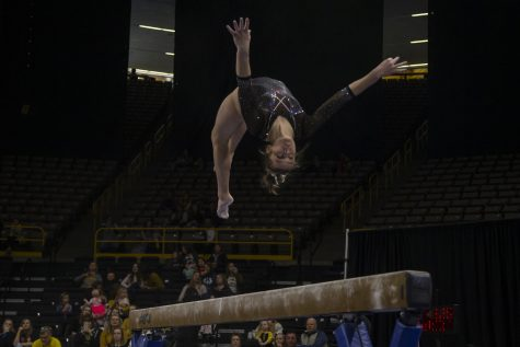 Iowa's all-around Mackenzie Vance performs on the beam during a women's gymnastics meet between Iowa and West Virginia on Sunday, March 8, 2020 at The Carver Hawkeye Arena. The Hawkeyes defeated the Mountaineers 196.750-196.175. Vance earned a score of 9.700.