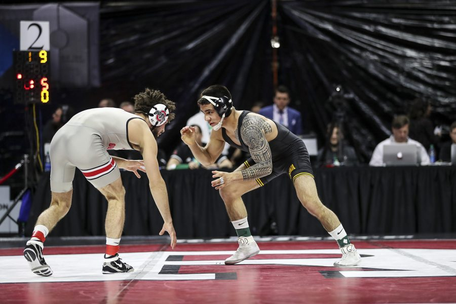 Iowa's 149-pound Pat Lugo grapples with Ohio State's  Sammy Sasso during the final session of the Big Ten Wrestling Tournament in Piscataway, NJ, on Sunday, March 8, 2020. Lugo won by decision 2-1, securing the 149-pound championship, and Iowa won the team title with 157.5 points.