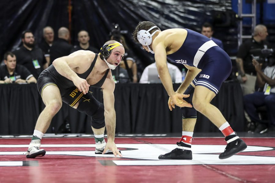 Iowa's 165-pound Alex Marinelli grapples with Penn State's  Vincenzo Joseph during the final session of the Big Ten Wrestling Tournament in Piscataway, N.J. on Sunday, March 8, 2020. Marinelli won by decision 3-2, securing the 165-pound championship, and Iowa won the team title with 157.5 points.