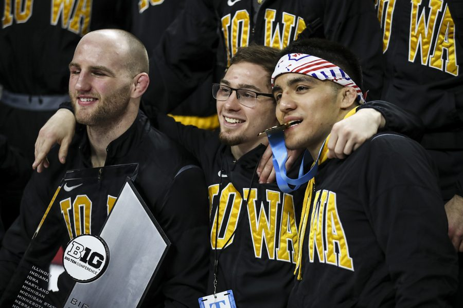 Iowa's 165-pound Alex Marinelli, 125-pound Spencer Lee, and 149-pound Pat Lugo smile for a photo after all three won their respective championships  during the final session of the Big Ten Wrestling Tournament in Piscataway, N.J., on Sunday, March 8, 2020. Iowa won the team title with 157.5 points.
