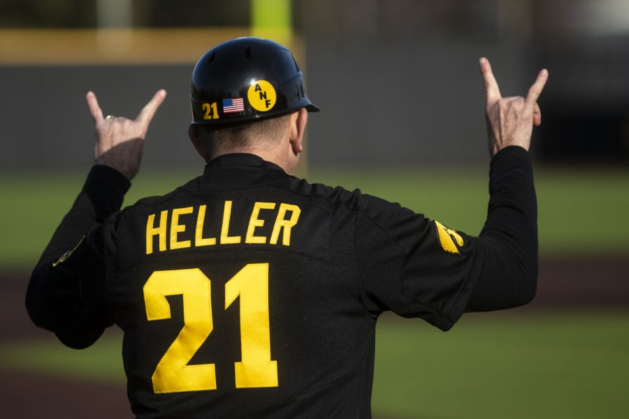 Iowa head coach Rick Heller celebrates after a run during a baseball game between the Iowa Hawkeyes and the Kansas Jayhawks on Tuesday, March 10, at Duane Banks Field. The Hawkeyes defeated the Jayhawks, 8-0.