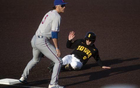 Iowa outfielder Justin Jenkins slides into third during a baseball game between the Iowa Hawkeyes and the Kansas Jayhawks on Tuesday, March 10, at Duane Banks Field. The Hawkeyes defeated the Jayhawks, 8-0.