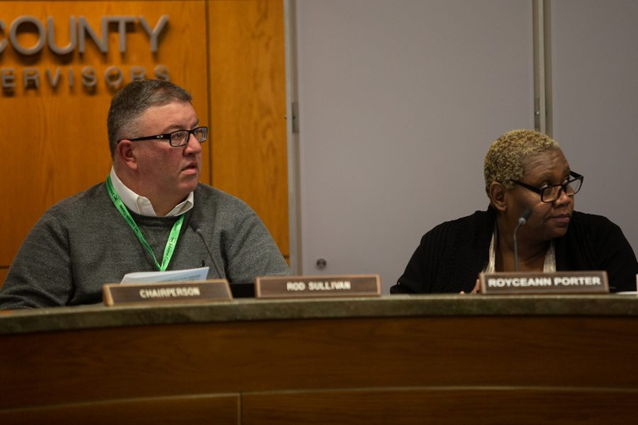 Johnson County Supervisors Rod Sullivan and Royceeann Porter  listen to a presentation during a meeting on Thursday, Feb. 12, 2020.