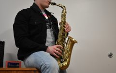 "Easa Aristizabal plays George Micheals ""Careless Whisper"" on his saxophone  on Monday, Feb. 24, 2020."