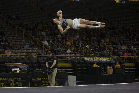 Iowa's all-around Bennet Huang performs his floor routine during a gymnastics meet at Carver Hawkeye Arena against Minnesota and the University of Illinois at Chicago on Saturday, Feb. 1, 2020. The Hawkeyes won with a final team score of 400.00. Huang earned a score of 14.000.