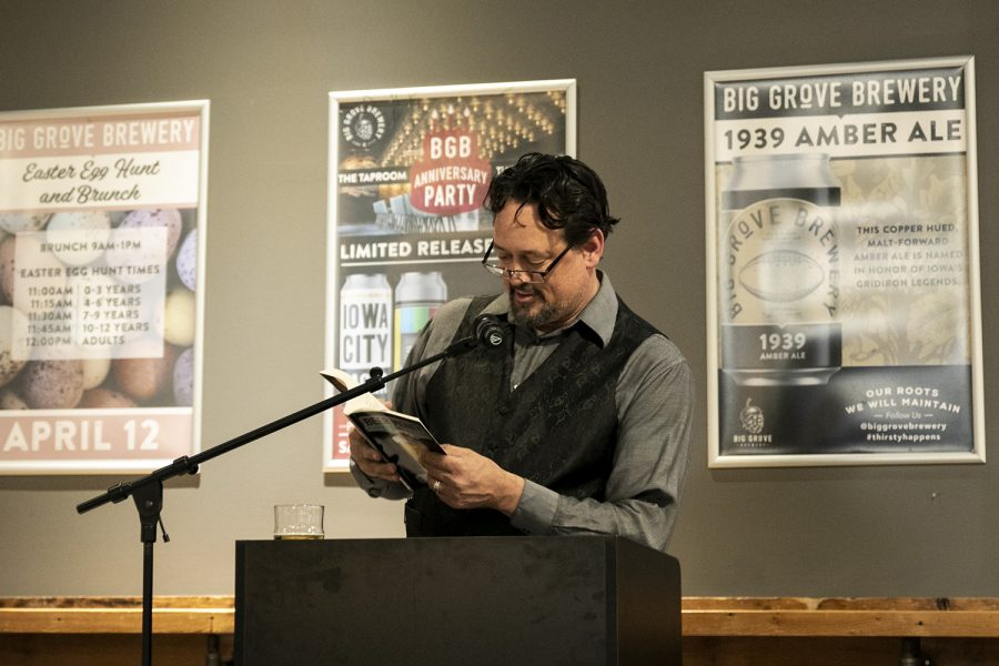 S.C. Sherman reads a few chapters from his book as seen at Big Groove Brewery on Tuesday, March 11, 2020.