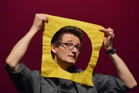 Comedian and magician Grant Freeman makes a man in the moon joke while telling a story at the Coralville Center for Performing Arts on Wednesday March 4, 2020.