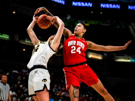 Ohio State guard Kierstan Bell blocks Iowa guard McKenna Warnock's shot during the Iowa vs. Ohio State Women's Big Ten Tournament game at Bankers Life Fieldhouse in Indianapolis on Friday, March 6, 2020. The Buckeyes defeated the Hawkeyes 87-66.