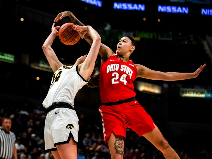 Ohio+State+guard+Kierstan+Bell+blocks+Iowa+guard+McKenna+Warnock%27s+shot+during+the+Iowa+vs.+Ohio+State+Women%27s+Big+Ten+Tournament+game+at+Bankers+Life+Fieldhouse+in+Indianapolis+on+Friday%2C+March+6%2C+2020.+The+Buckeyes+defeated+the+Hawkeyes+87-66.