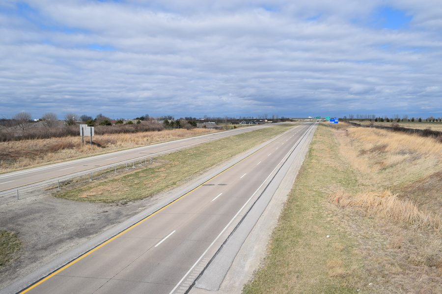 A section of U.S. Highway 218 leading to Iowa City is seen empty in Mount Pleasant, Iowa on Sunday. Social distancing has reduced travel around the country in response to the COVID-19 pandemic.