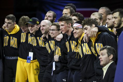Members of the Iowa wrestling team pose for a photo after winning the team title during the final session of the Big Ten Wrestling Tournament in Piscataway, NJ, on Sunday, March 8, 2020. Iowa won the team title with 157.5 points.
