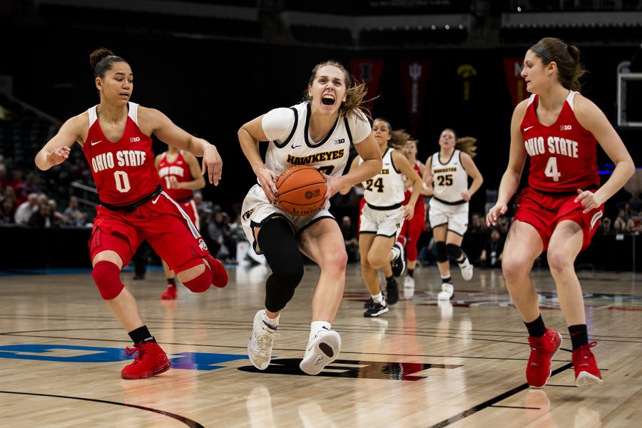 Iowa guard Kathleen Doyle drives the ball during the Iowa vs. Ohio State Women's Big Ten Tournament game at Bankers Life Fieldhouse in Indianapolis on Friday, March 6, 2020. The Buckeyes defeated the Hawkeyes 87-66.
